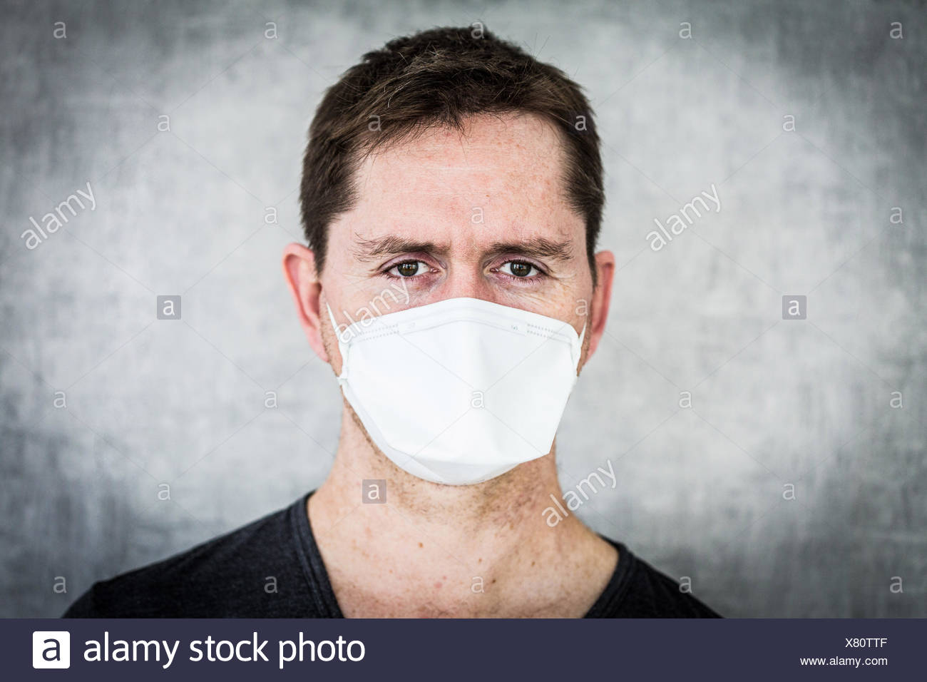 Man wearing a face mask. - Stock Image