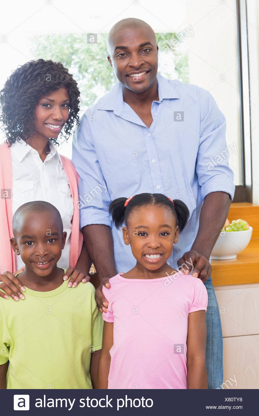 Happy family standing and smiling at camera Stock Photo
