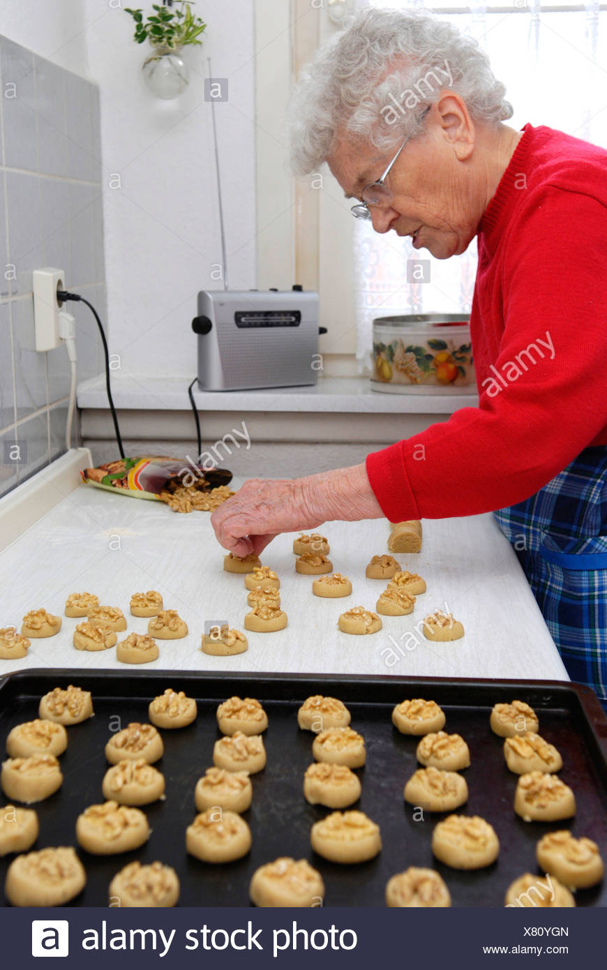 Old woman baking cookies Stock Photo
