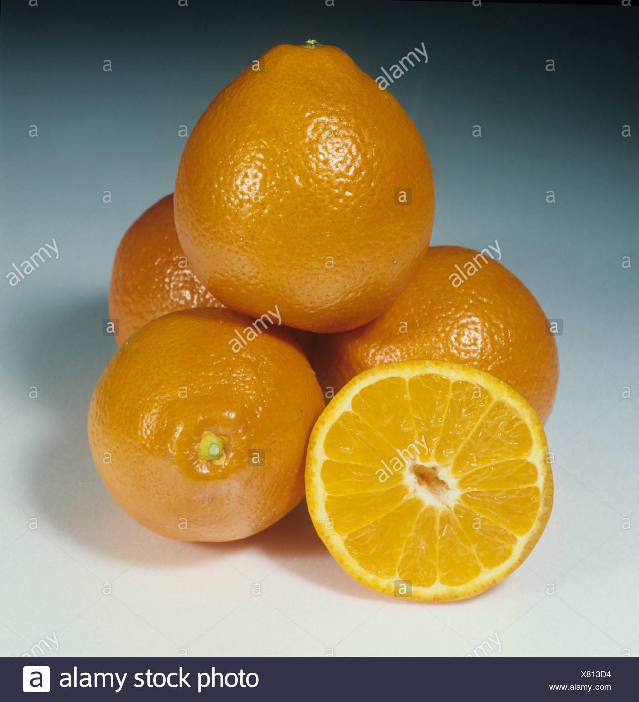 Whole and sectioned orange fruit variety Mineola Tangelo - Stock Image