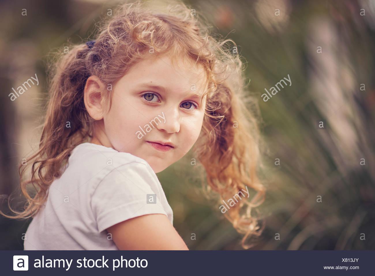Girl looking over her shoulder - Stock Image