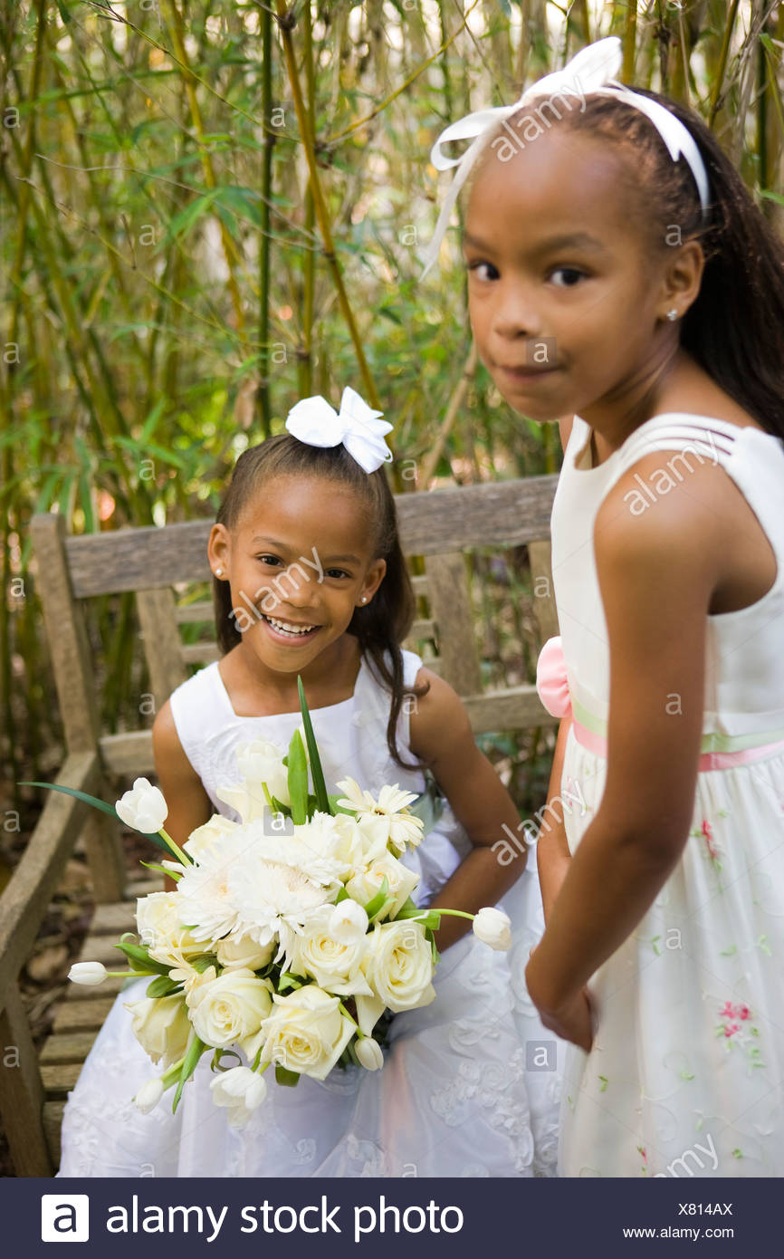 Cute african american girl holding flower stock photos cute happy african american flower girls holding bouquet of white flowers stock image izmirmasajfo