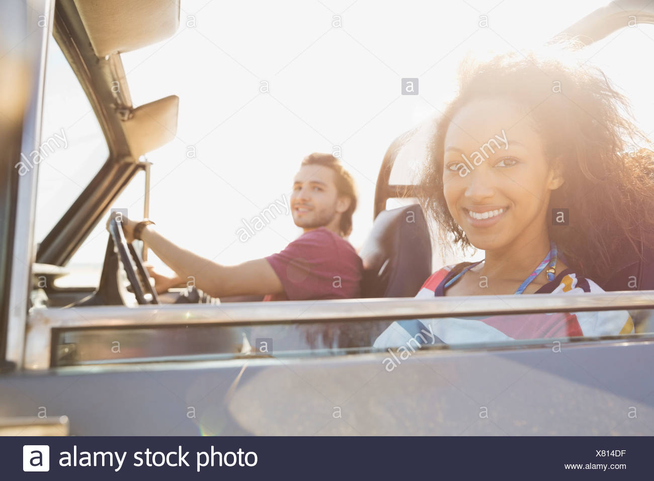 Woman with boyfriend on road trip - Stock Image