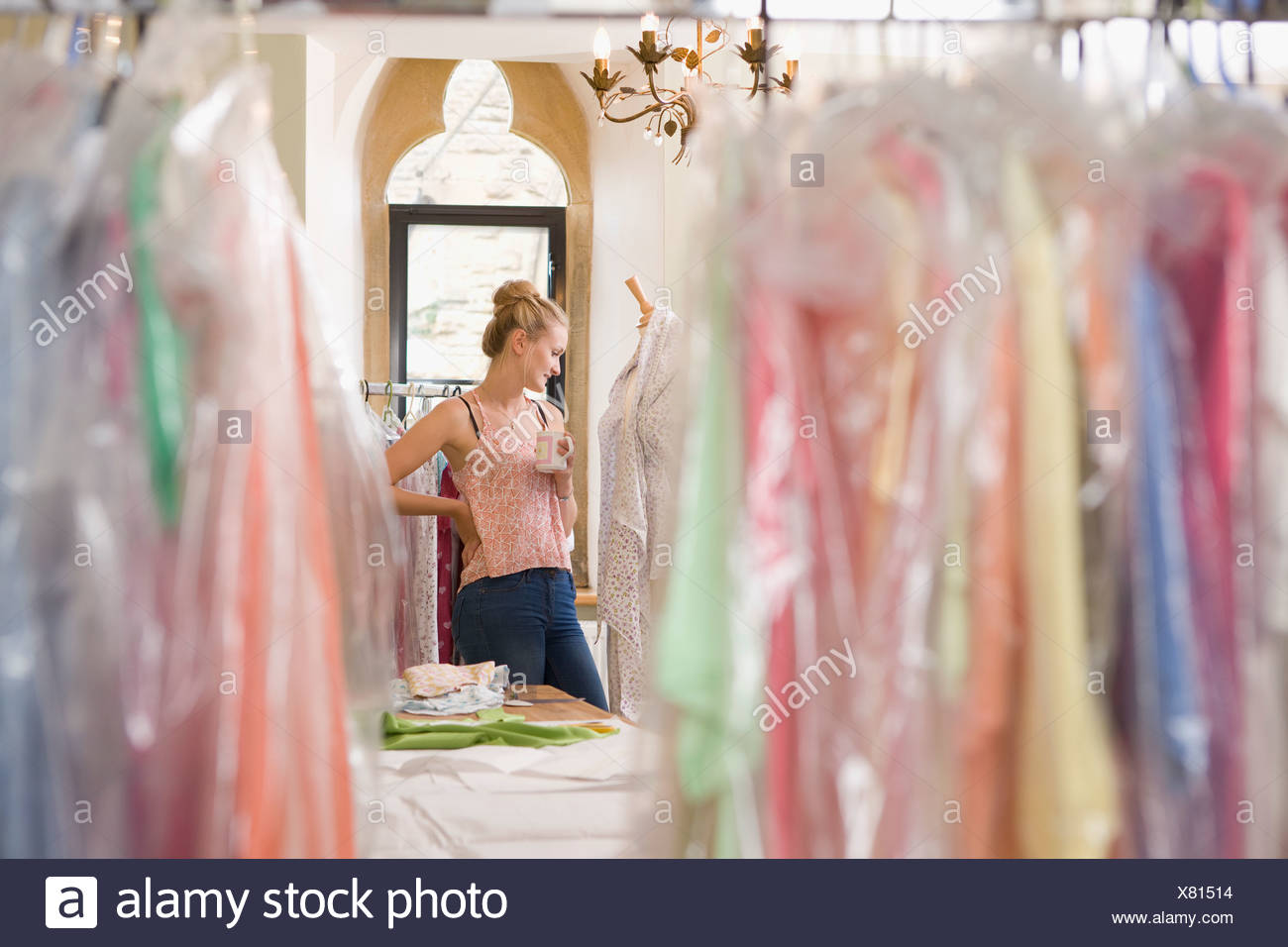 Fashion Designer Relaxing In Design Studio - Stock Image