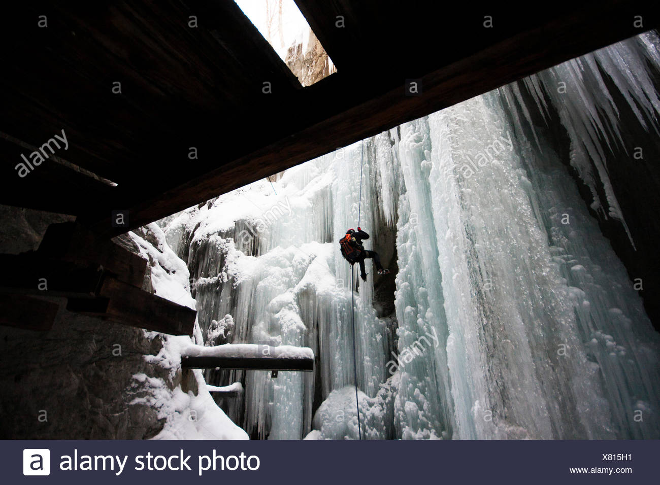 A Man Rappelling From An Icefall - Stock Image