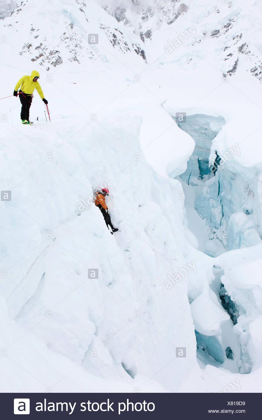 Mountain rangers practise a crevasse rescue on a glacier on Mount McKinley, also know as Denali, in Alaska. - Stock Image