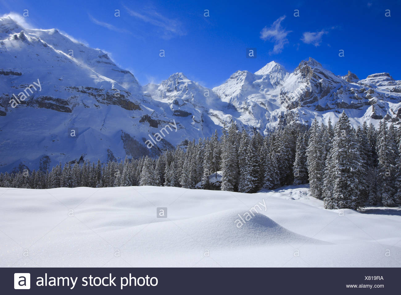 snowy mountain scenery with Blueemlisalp Rothorn, Blueemlisalphorn, Oeschinenhorn, Switzerland, Bernese Alps - Stock Image