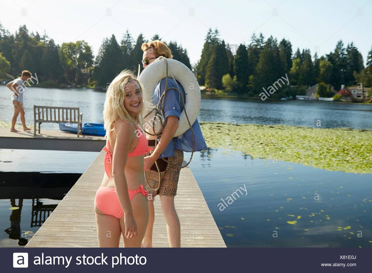 Friends going canoeing in lake, Seattle, Washington, USA - Stock Image