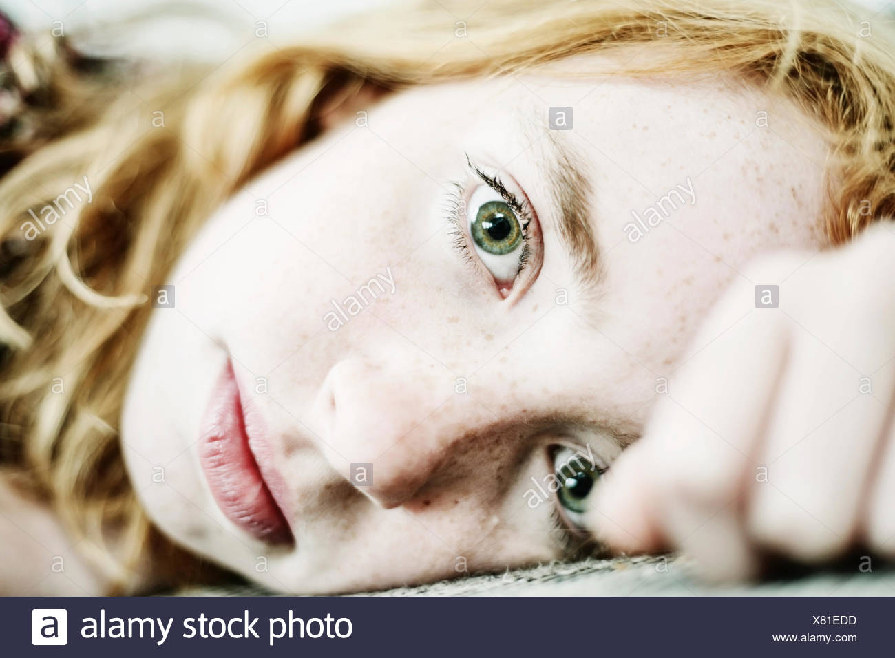 Portrait of girl   freckles and green eyes - Stock Image