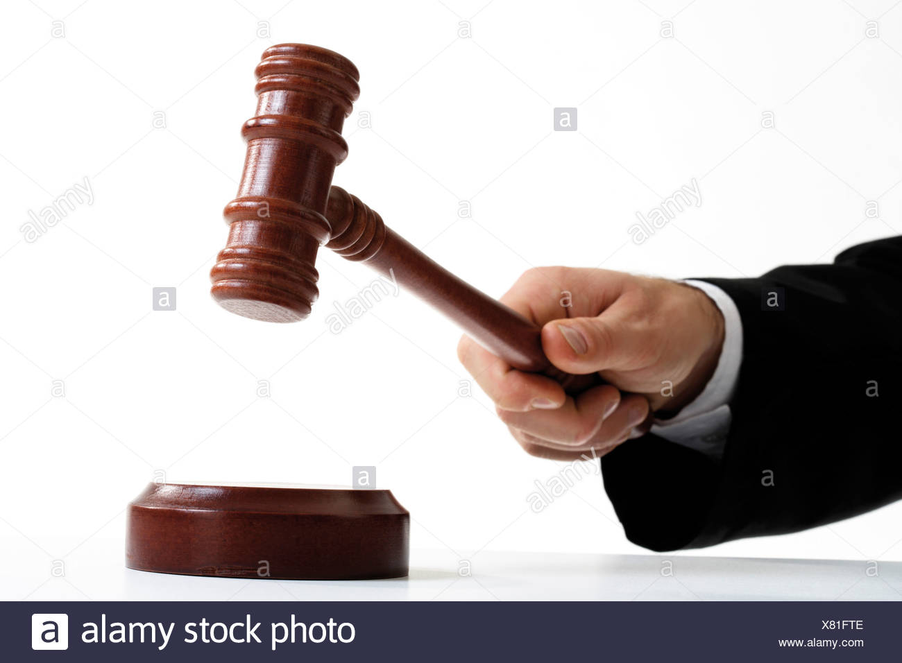 Hand with auctioneer´s hammer - Stock Image