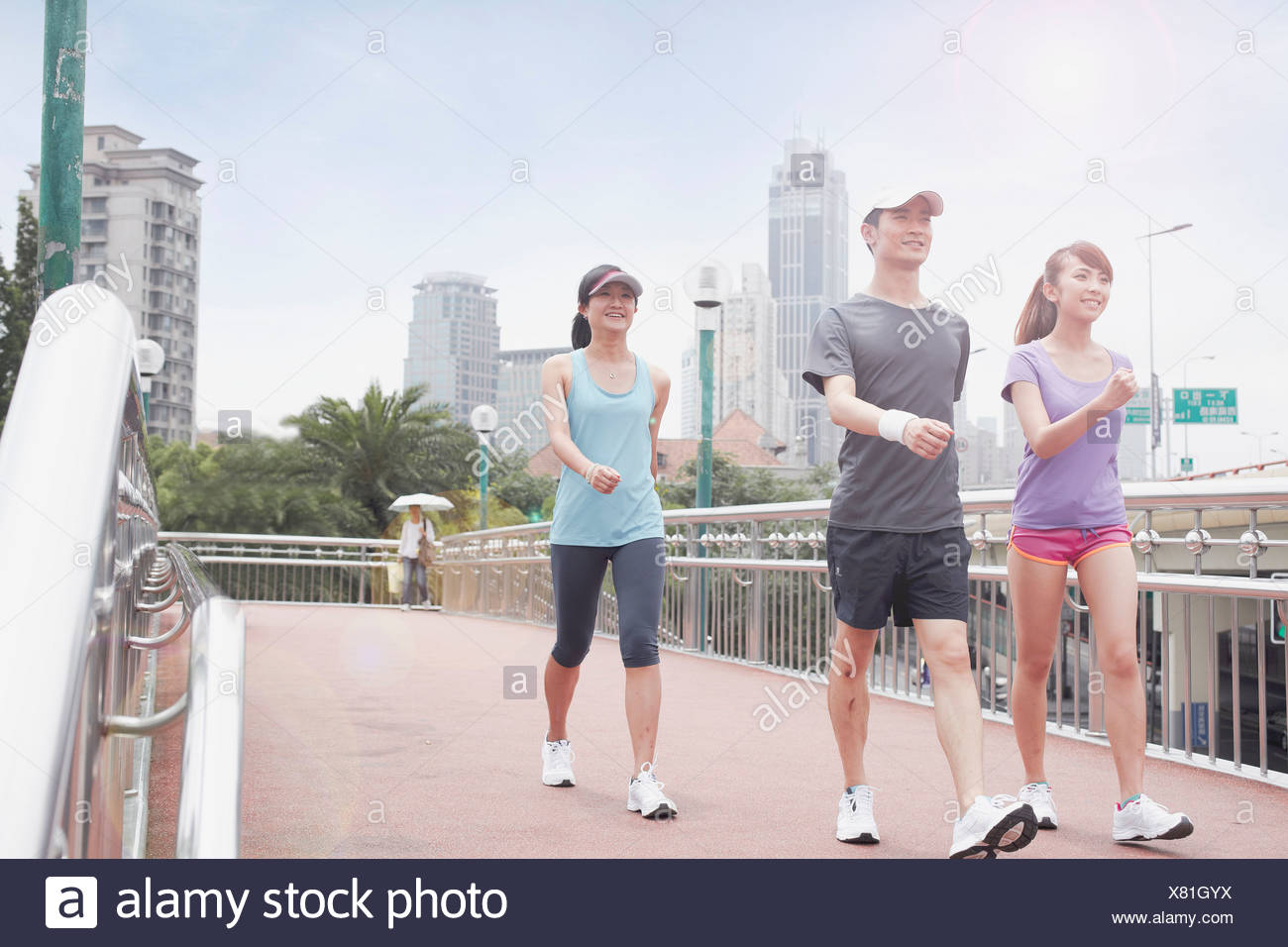 Young people walking in Shanghai, China - Stock Image