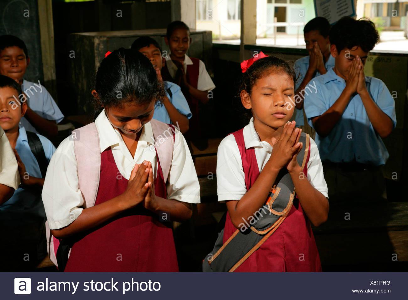 Schoolchildren reciting morning prayers, Arawak natives, Santa Mission, Guyana, South America - Stock Image