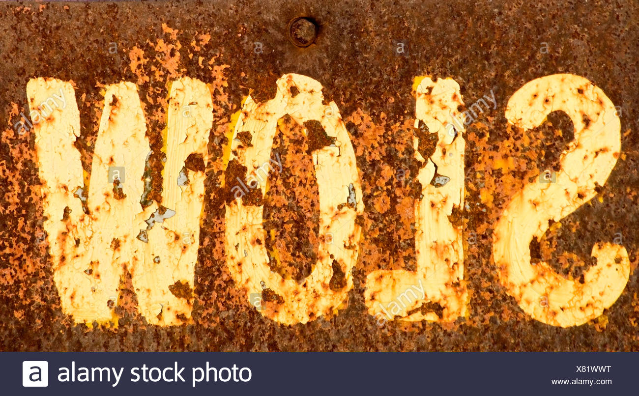 Western script on peeling wall, close-up - Stock Image