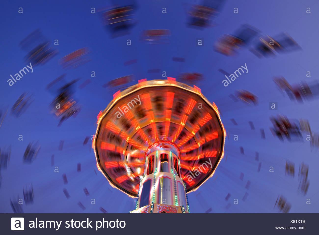 Night scene, fisheye shot, Chair-O-Planes or Swing Carousel, Cannstatt Festival, Stuttgart Beer Festival, Stuttgart, Baden-Wuer Stock Photo