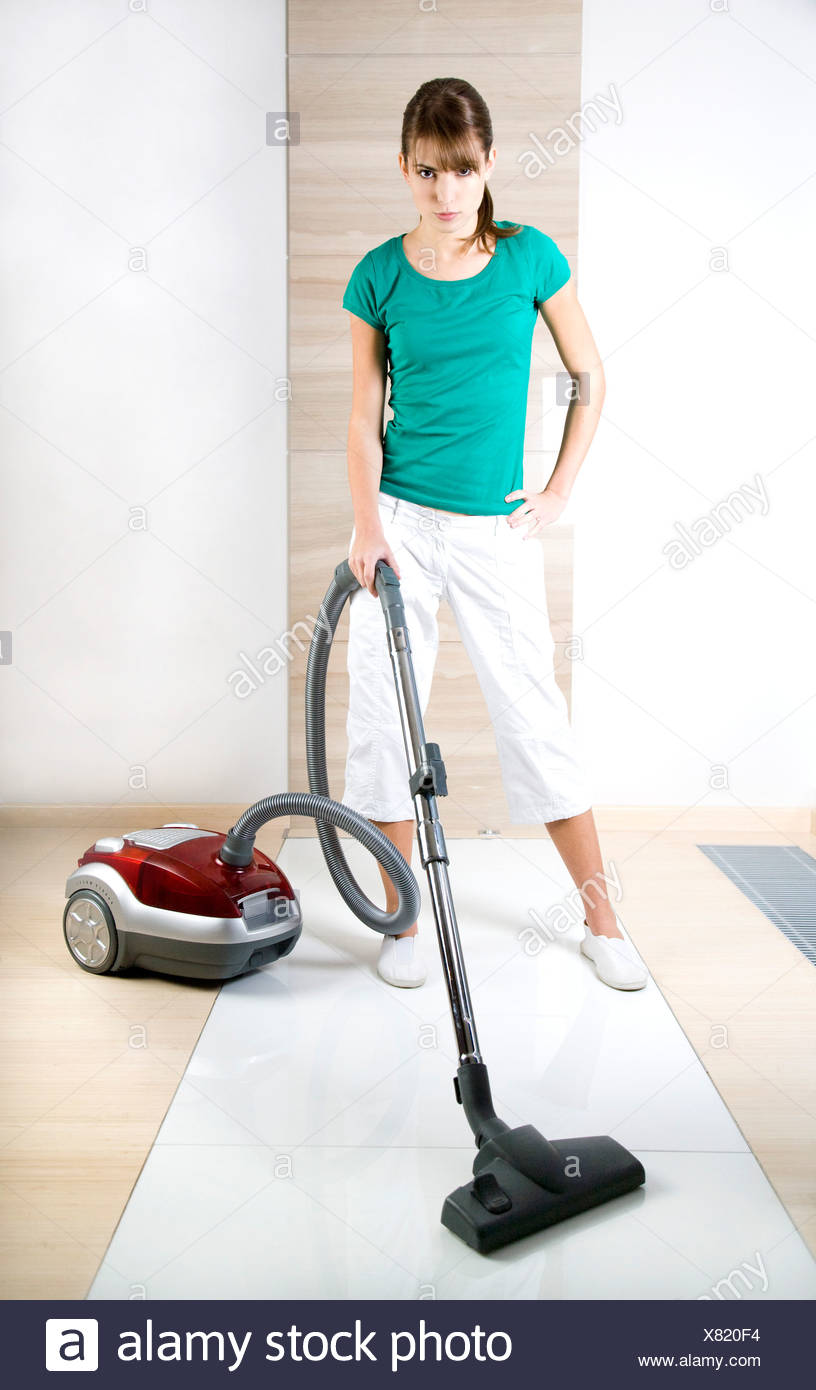 young woman hovering flat - Stock Image