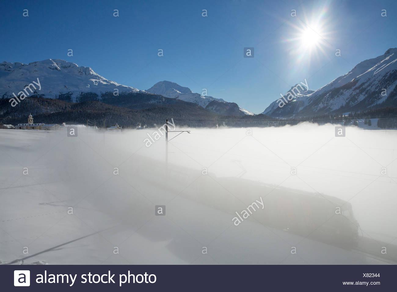 Engadin, Engadine, RHB Glacier express, Celerina, Inn, winter, canton, GR, Graubünden, Grisons, Upper Engadine, railway, train, - Stock Image