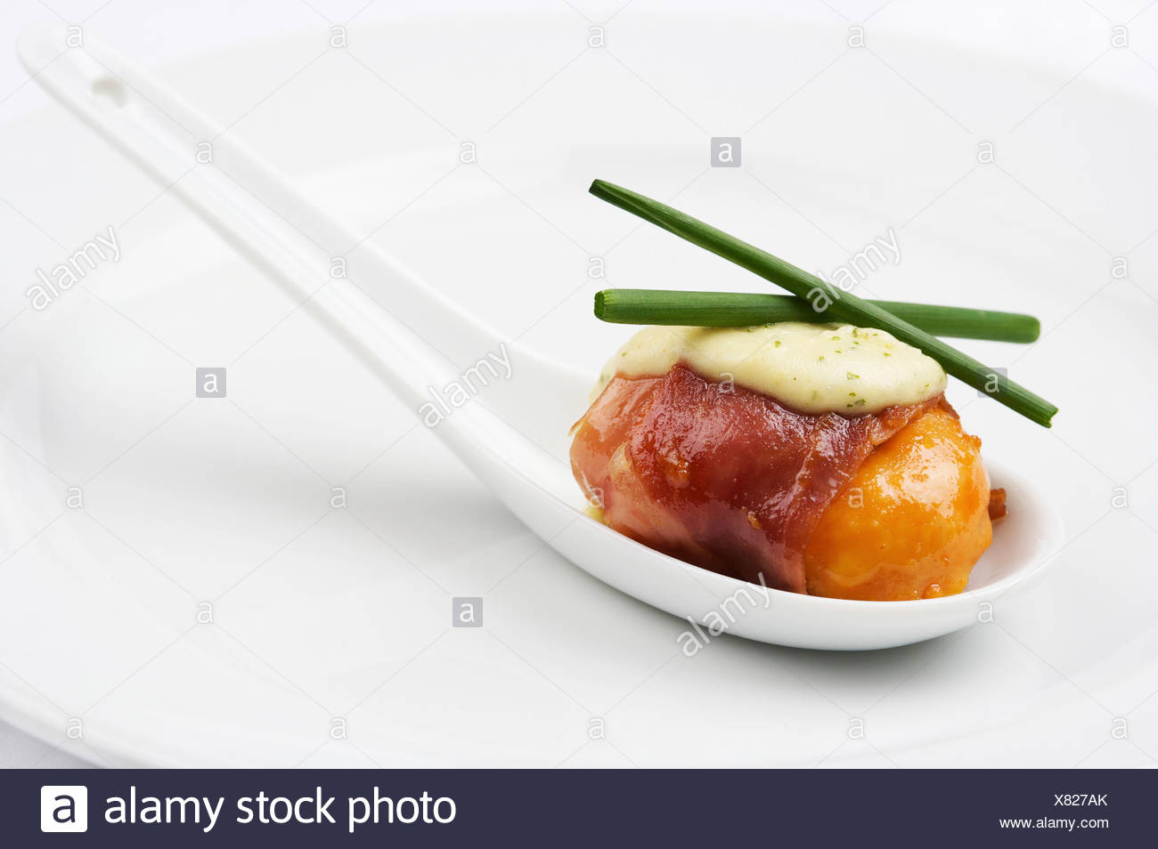 Spoon of scallop with pancetta - Stock Image