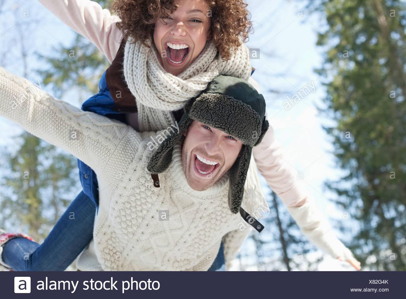 Enthusiastic couple piggybacking - Stock Image