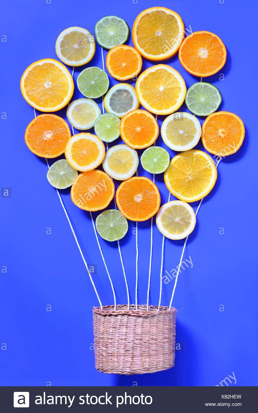 Abstract Citrus fruits and basket. - Stock Image