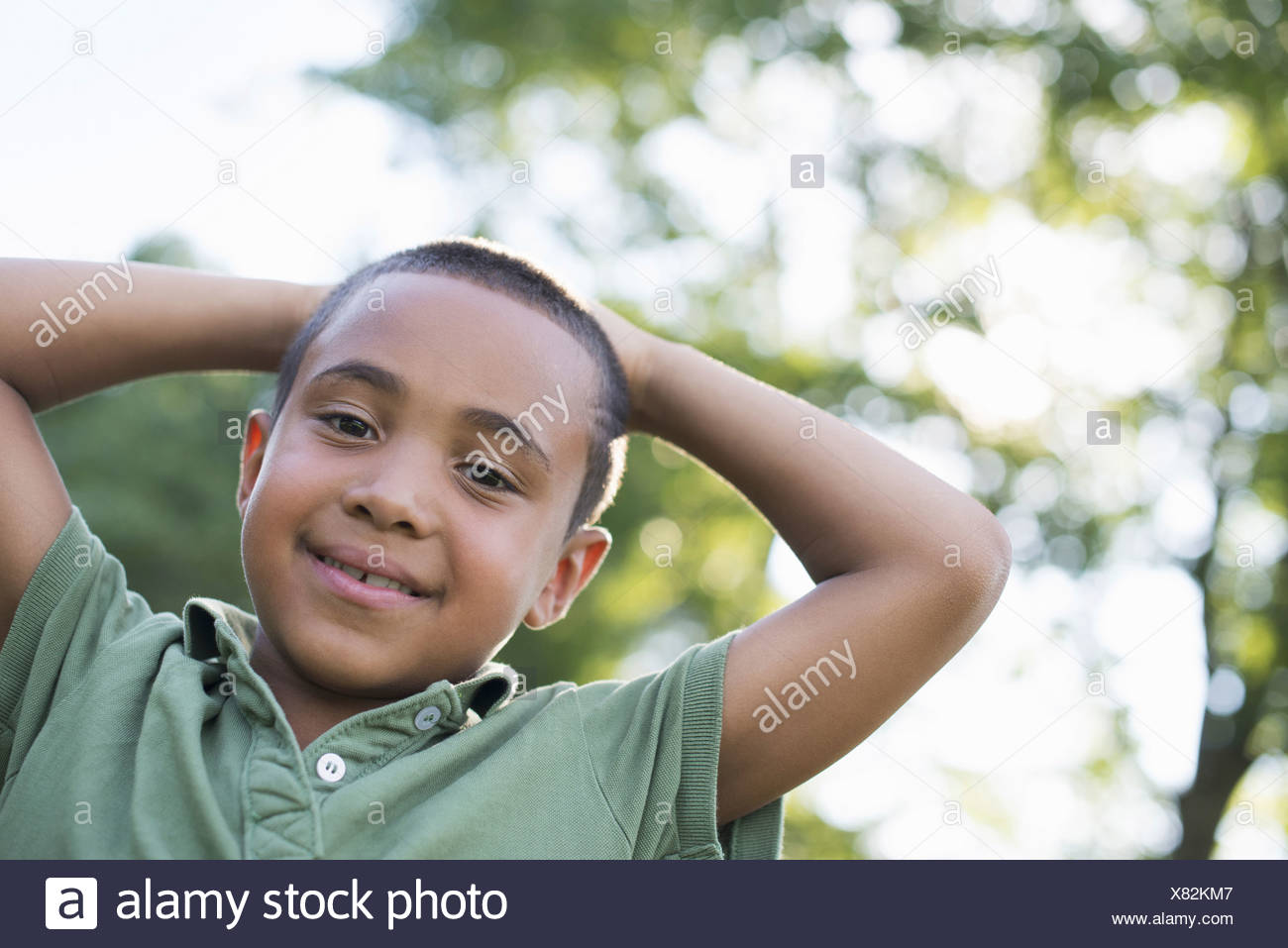 A young boy outdoors on a summer day - Stock Image
