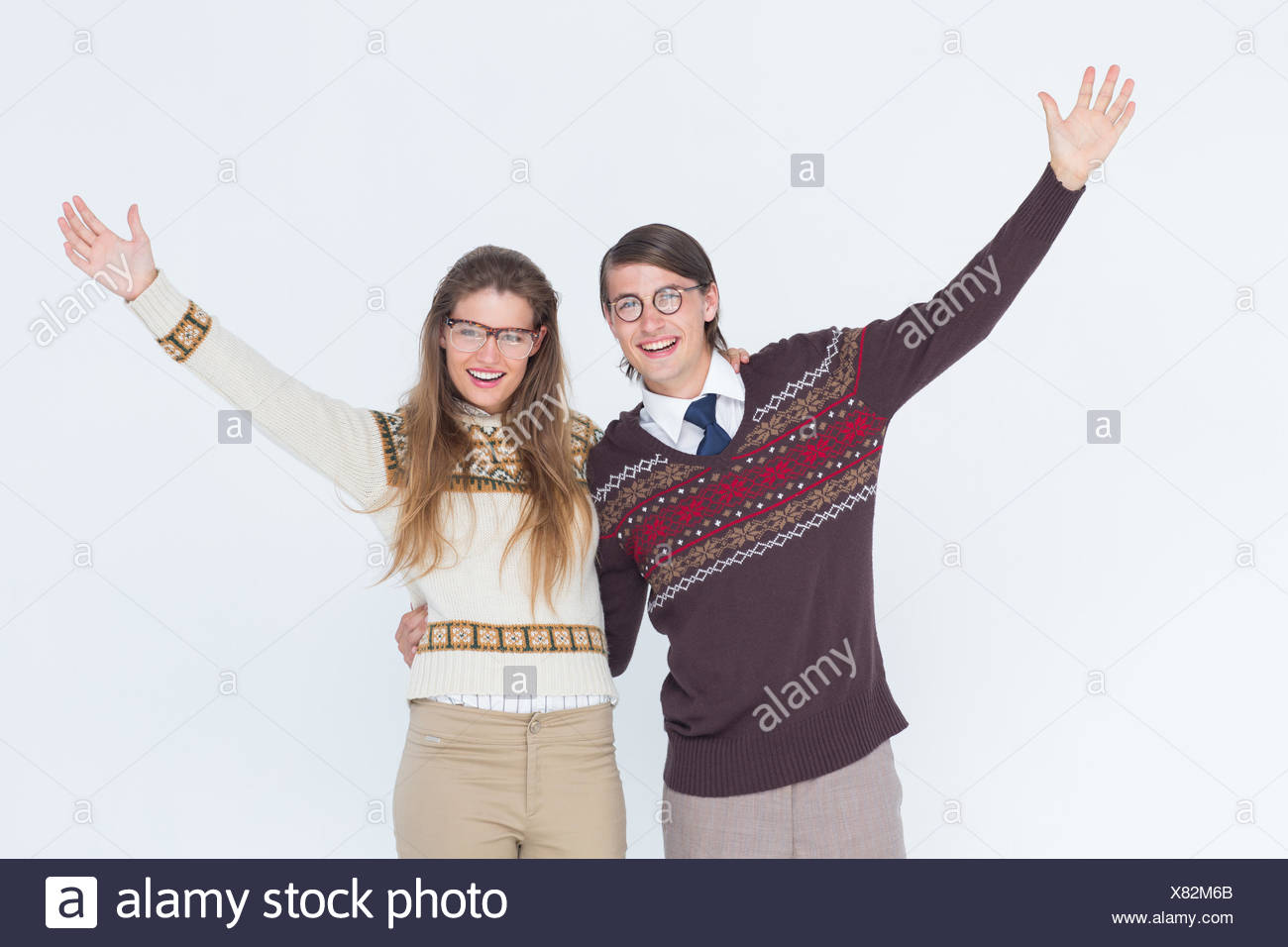 Happy geeky hipster couple embracing - Stock Image