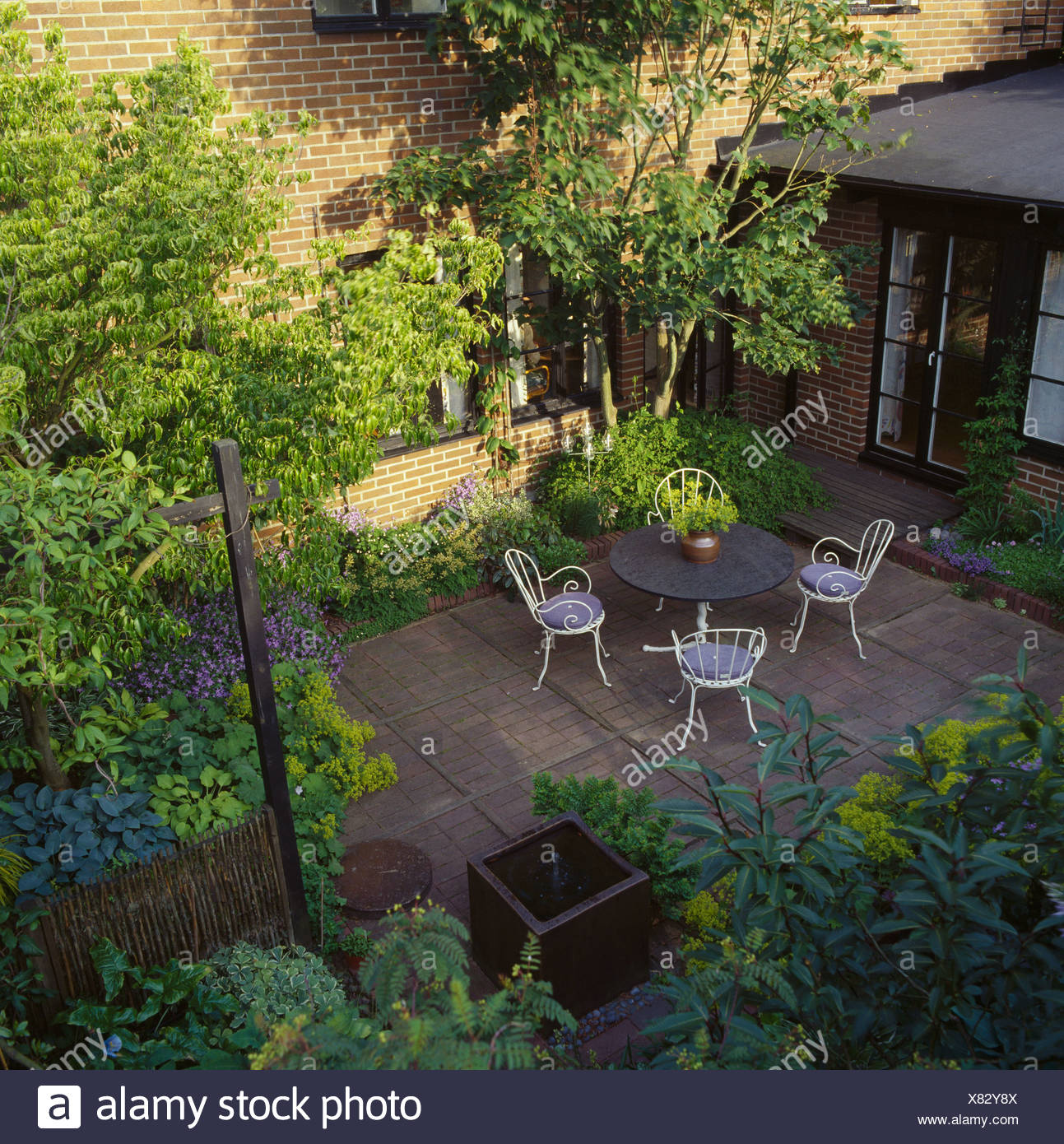 Birds-eye view of shady paved courtyard townhouse garden ... on courtyard decorating ideas, courtyard planting ideas, garden fence ideas, courtyard furniture ideas, bird bath garden ideas, house courtyard design ideas, courtyard plans ideas, enclosed courtyard ideas, courtyard gardening ideas, stone courtyard design ideas, cottage garden ideas, outdoor courtyard design ideas, courtyard landscape design, courtyard and front walkway ideas, courtyard paver ideas, front courtyard design ideas, small courtyard ideas, courtyard home ideas, courtyard terracotta,