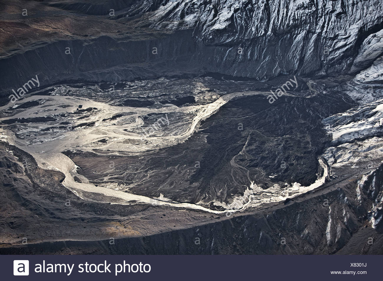 Gigjokull,-outlet glacier from Eyjafjallajokull.  Lagoon filled with mud and ash, Eyjafjallajokull Volcano Eruption, Iceland - Stock Image