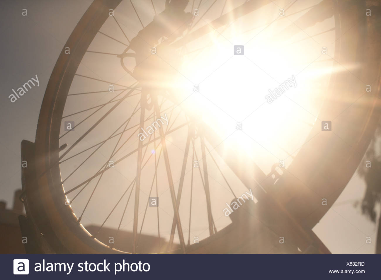 Bicycle wheel in bright sunlight - Stock Image