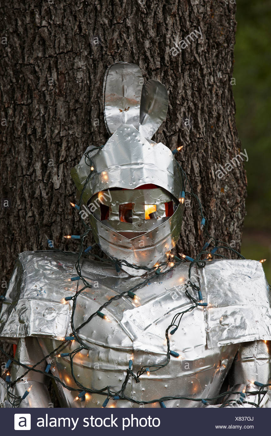 Suit of Armor, Wrapped in Christmas Lights - Stock Image