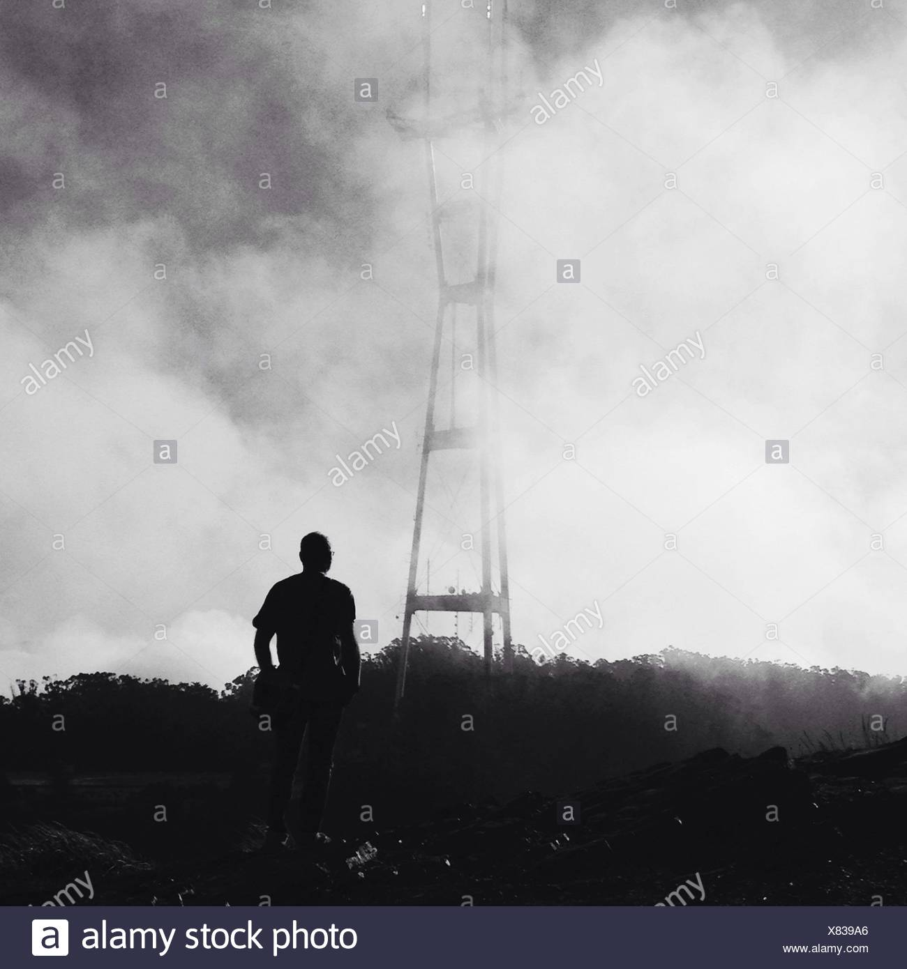 Man Standing Among Smoke - Stock Image