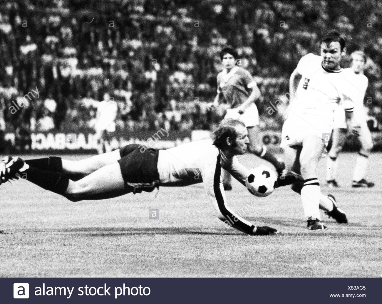 sports, football, games, Germany, DFB-Pokal 1969 / 1970, quarter final, game Borussia Moenchengladbach versus 1. FC Koeln (2:3), Boekelbergstadion, Gelsenkirchen, 5.8.1970, goal keeper Manfred Manglitz (Cologne repelling the attack of striker Herbert Laumen, DFB cup, football match, soccer match, football matches, footballer, footballers, kicker, football player, football players, action, act, actions, acts, attack, offensive move, attacks, offensive moves, defences, defenses, defense, defence, save, military parade, running, run, runs, jumping, jumps, jump, pl, Additional-Rights-Clearences-NA - Stock Image