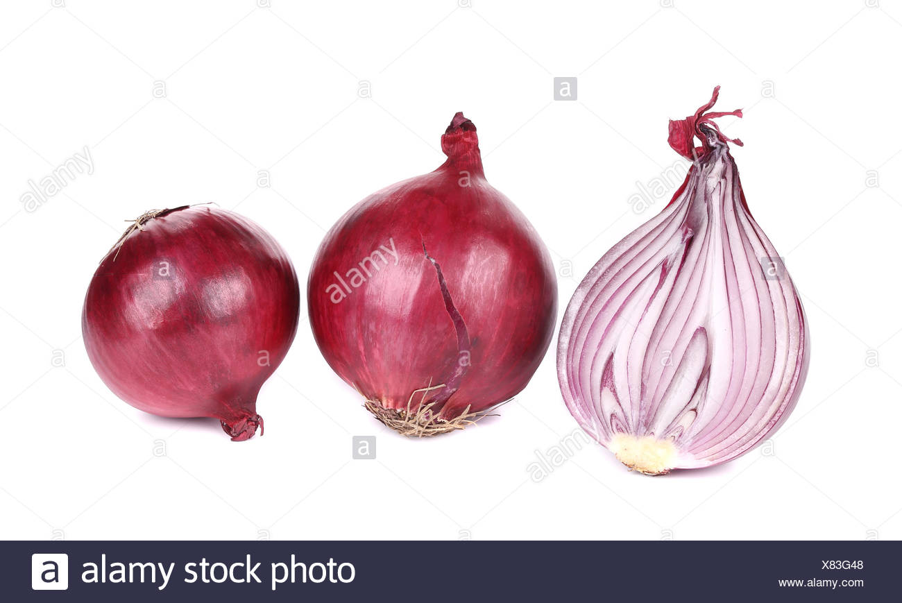 Three red onions in a row. - Stock Image