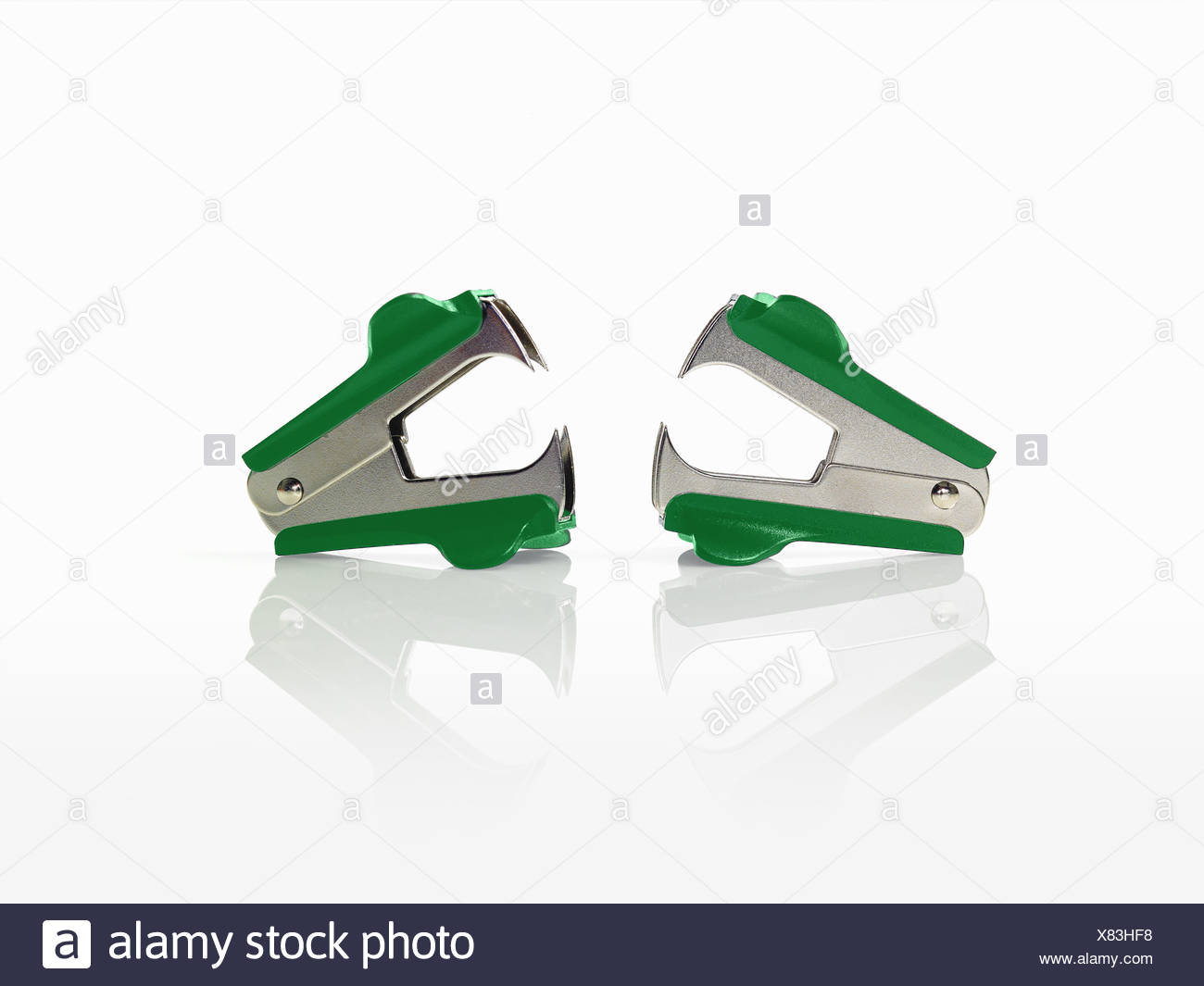 Two paperclip pincer removers. - Stock Image
