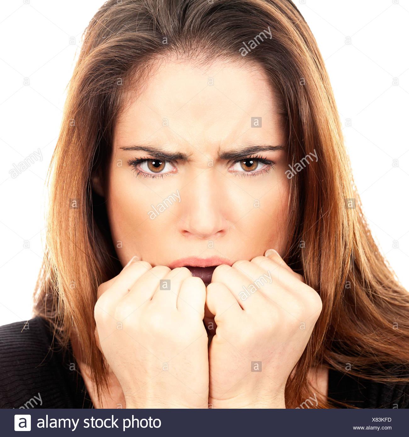 Beautiful Woman fear afraid anxious - Stock Image