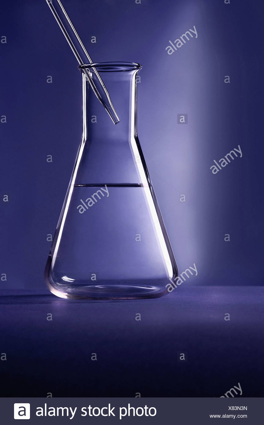 Dropper in graduated cylinder - Stock Image