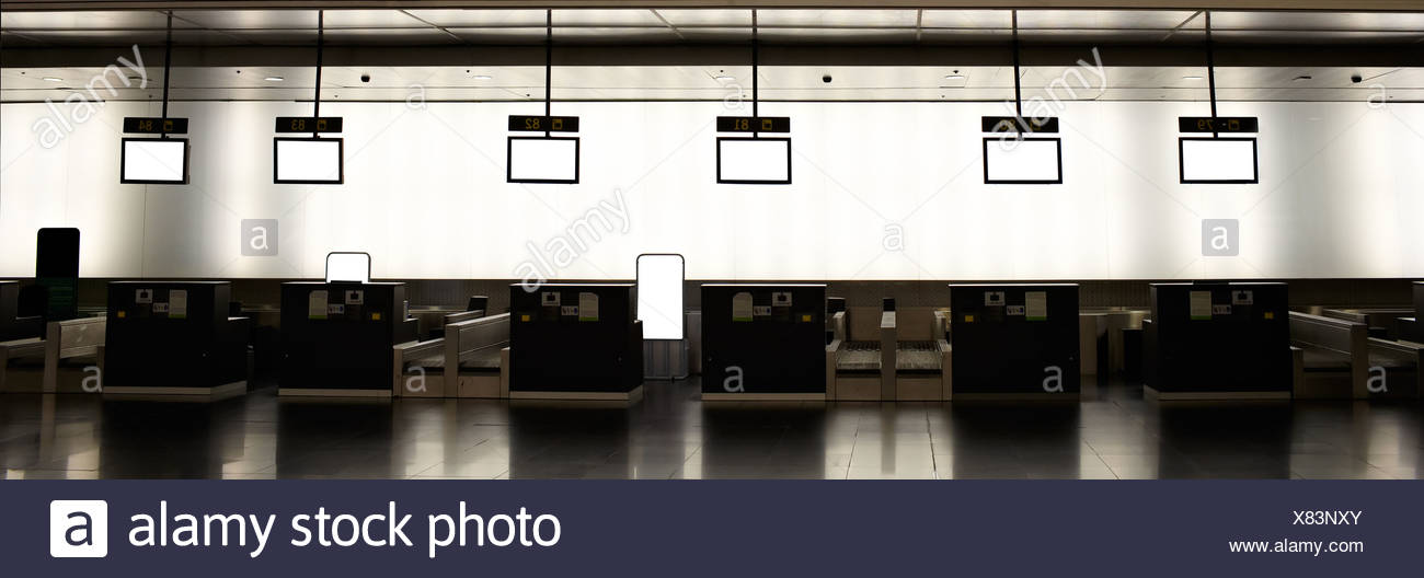 Empty airport check-ins - Stock Image