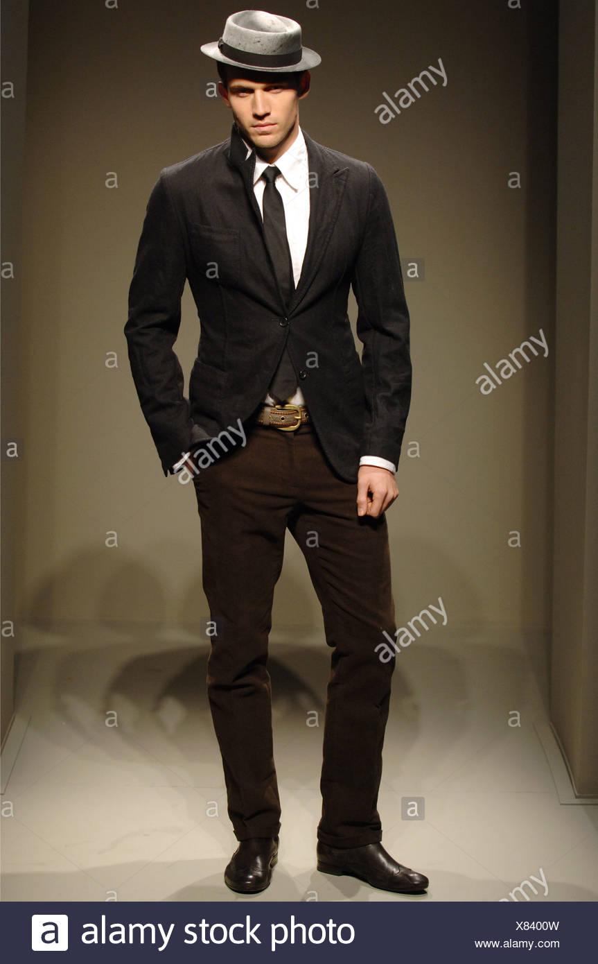 34f6b7230db69 Bottega Veneta Menswear Milan A W Male wearing a fitted black suit jacket  over a white button