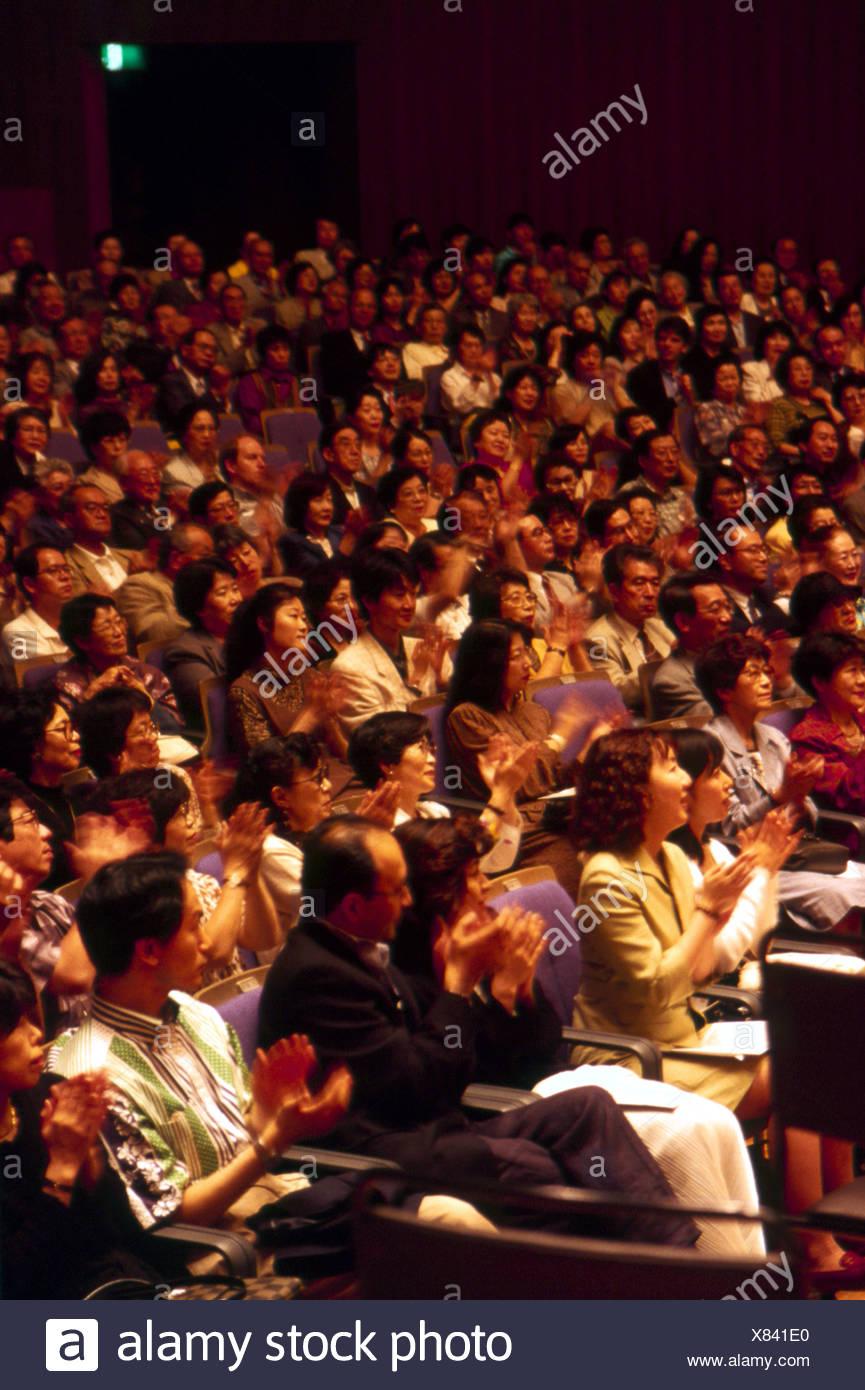 Japanese audience applauding Tokyo Geijutsu Gekijo Japan - Stock Image