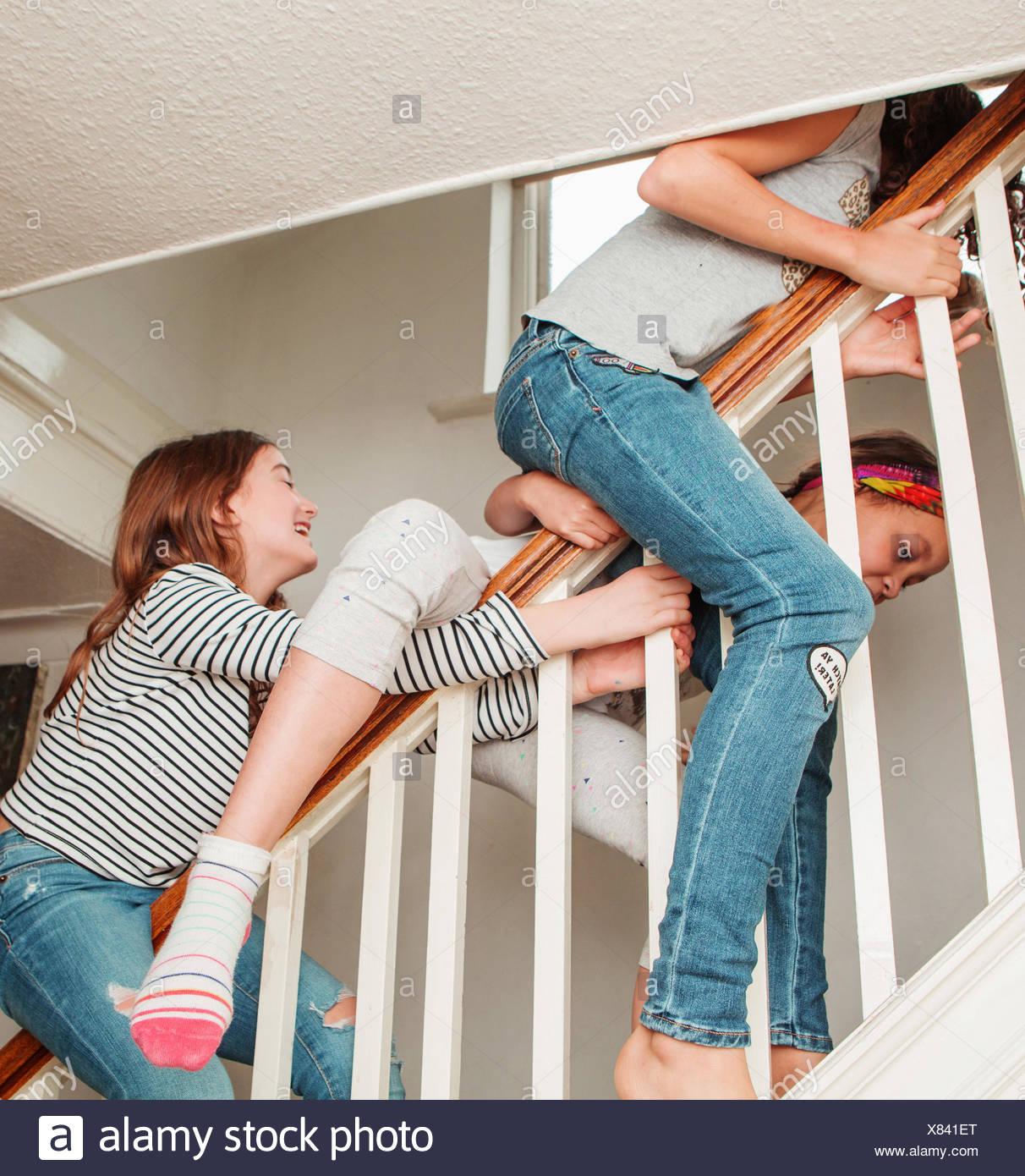Girls Sliding Down Banister Stock Photo: 280372144