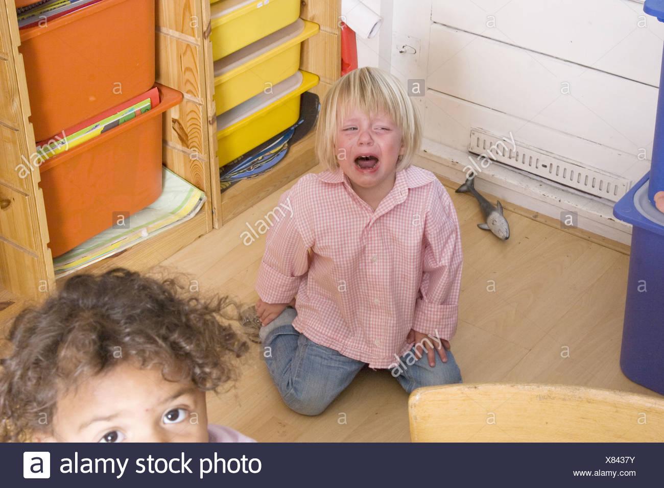 Brat child giving a toddler tantrum at toddler group Stock Photo