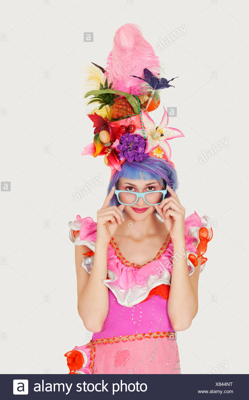 f9c56ead7c7a Portrait of beautiful young woman in Brazilian outfit over gray background  - Stock Image