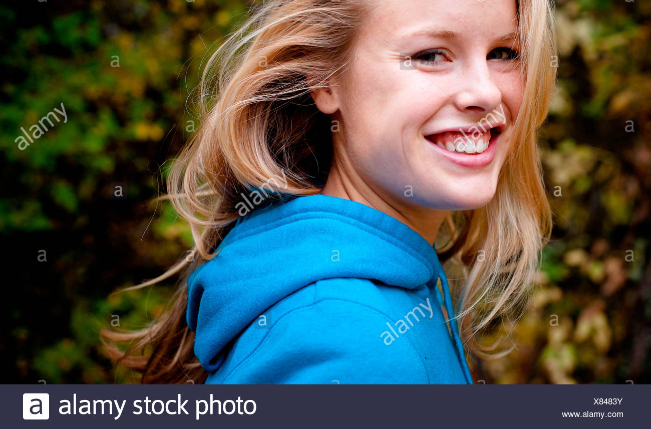 A female hiker smiles. - Stock Image