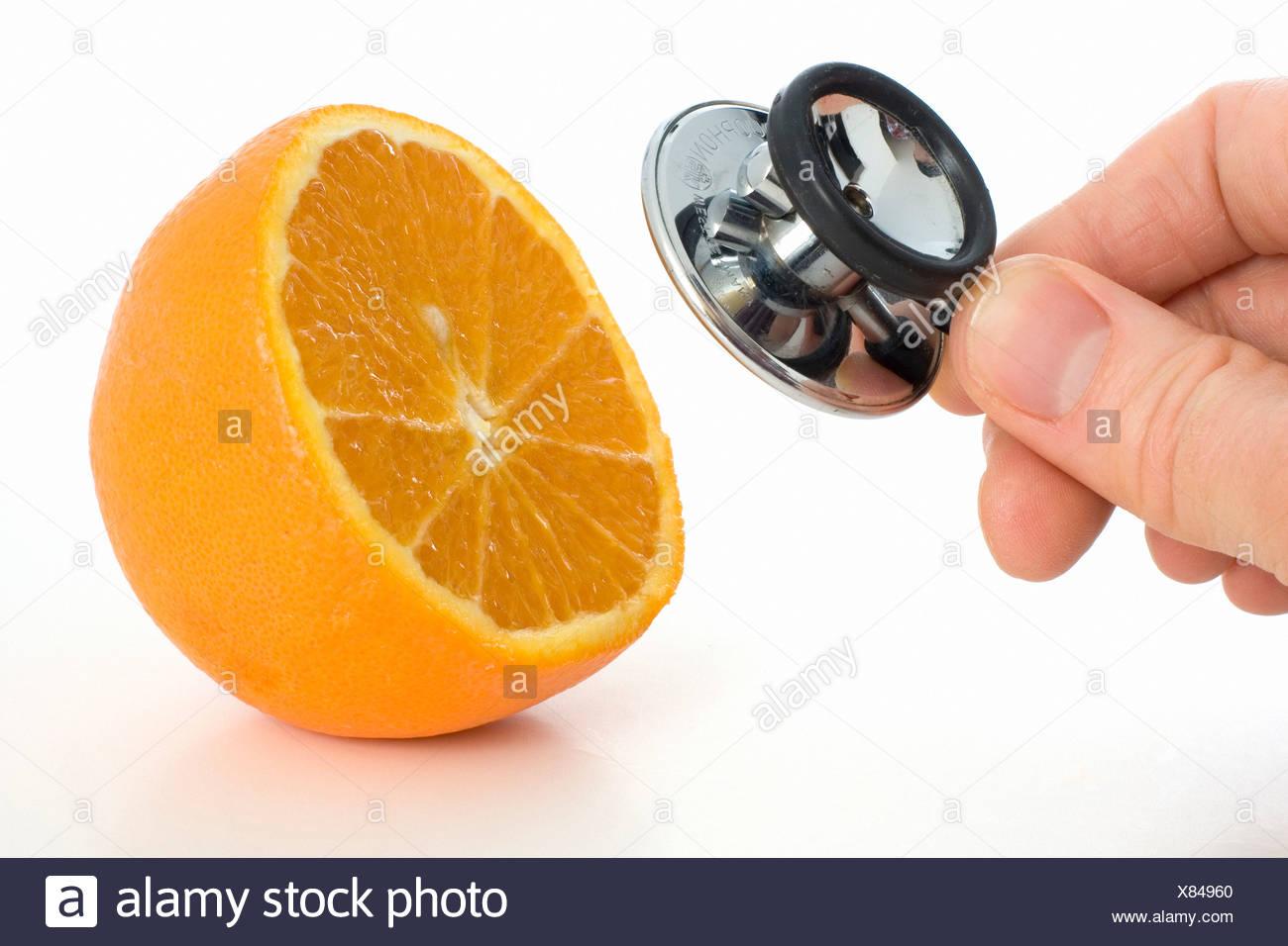 Orange, vitamin, vitamin C, vitamins, rich in vitamins, healthy, health, food, juice, fruit, cold, prevent, stethoscope, prevent - Stock Image