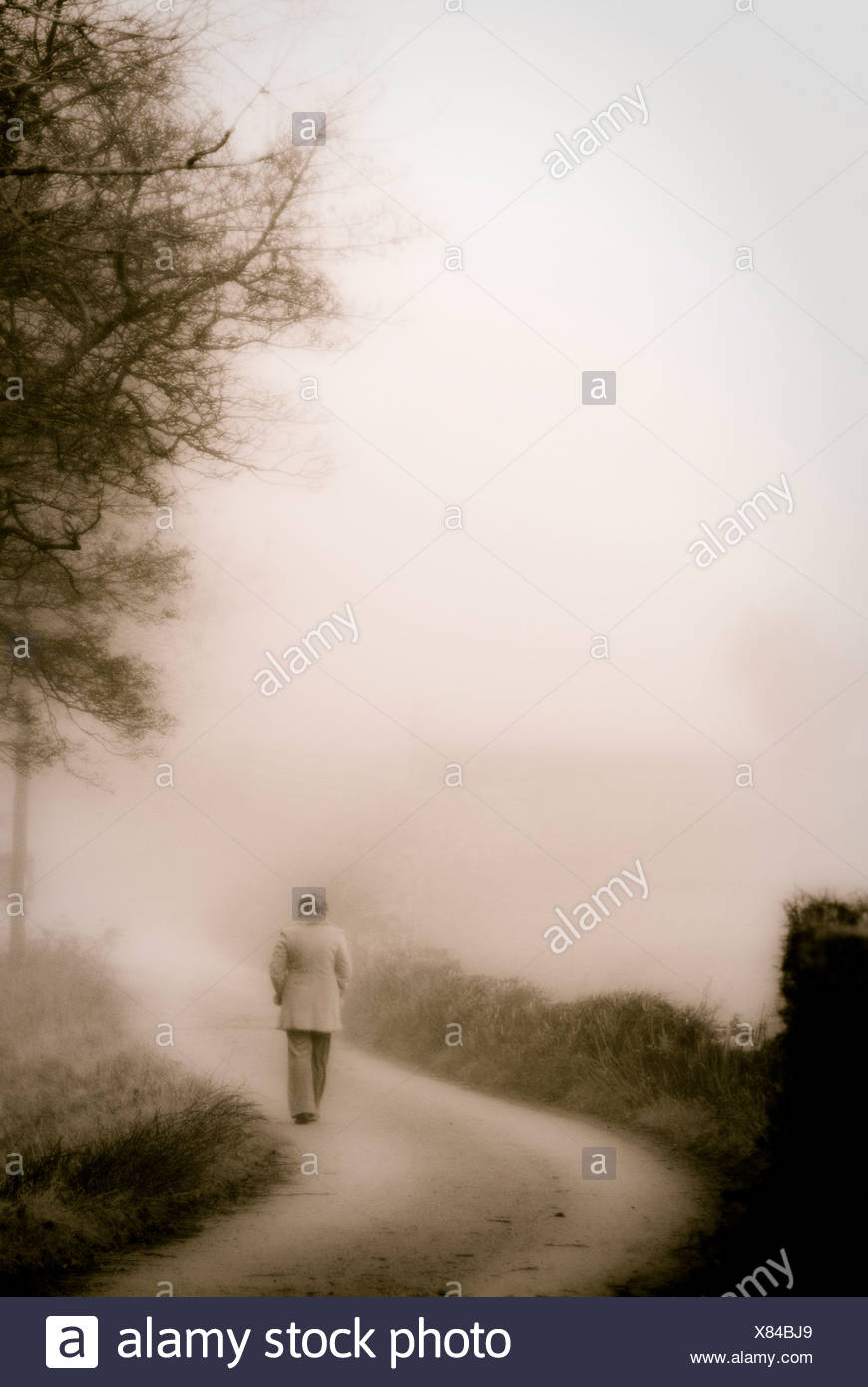 woman on country lane - Stock Image