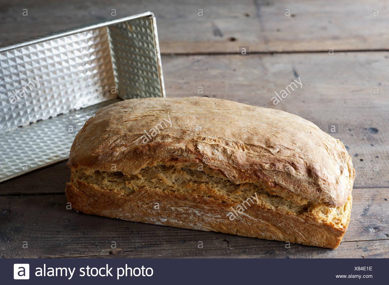Spelt bread, homemade, baking tray - Stock Image