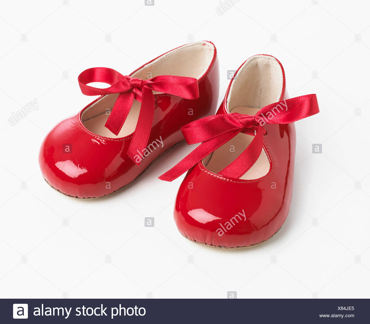 Red patent ribbon tie shoes - Stock Image