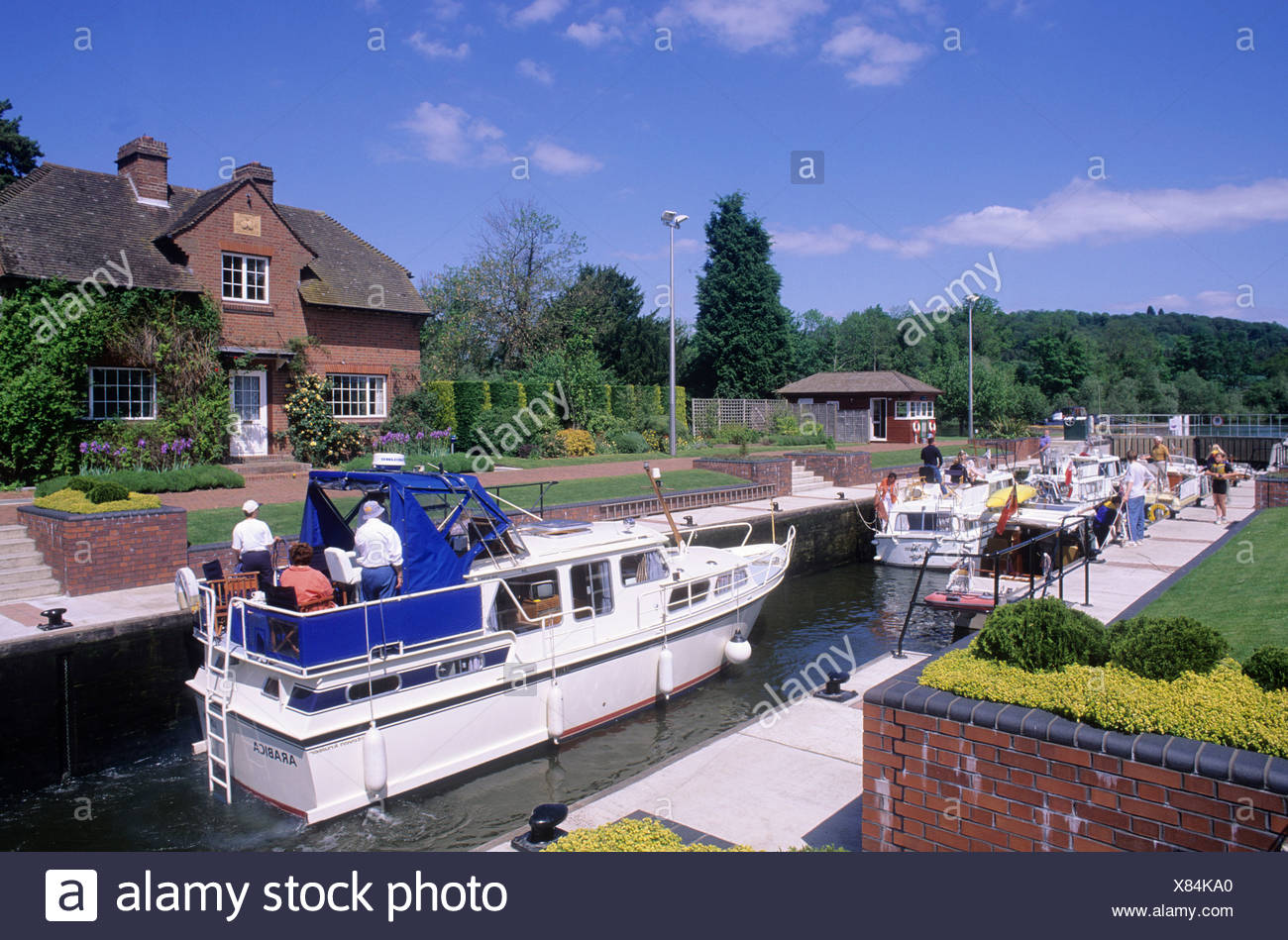 Hambleden Lock gates River Thames valley house cruising cruise cruisers boats people holidays afloat Berkshire England UK Stock Photo