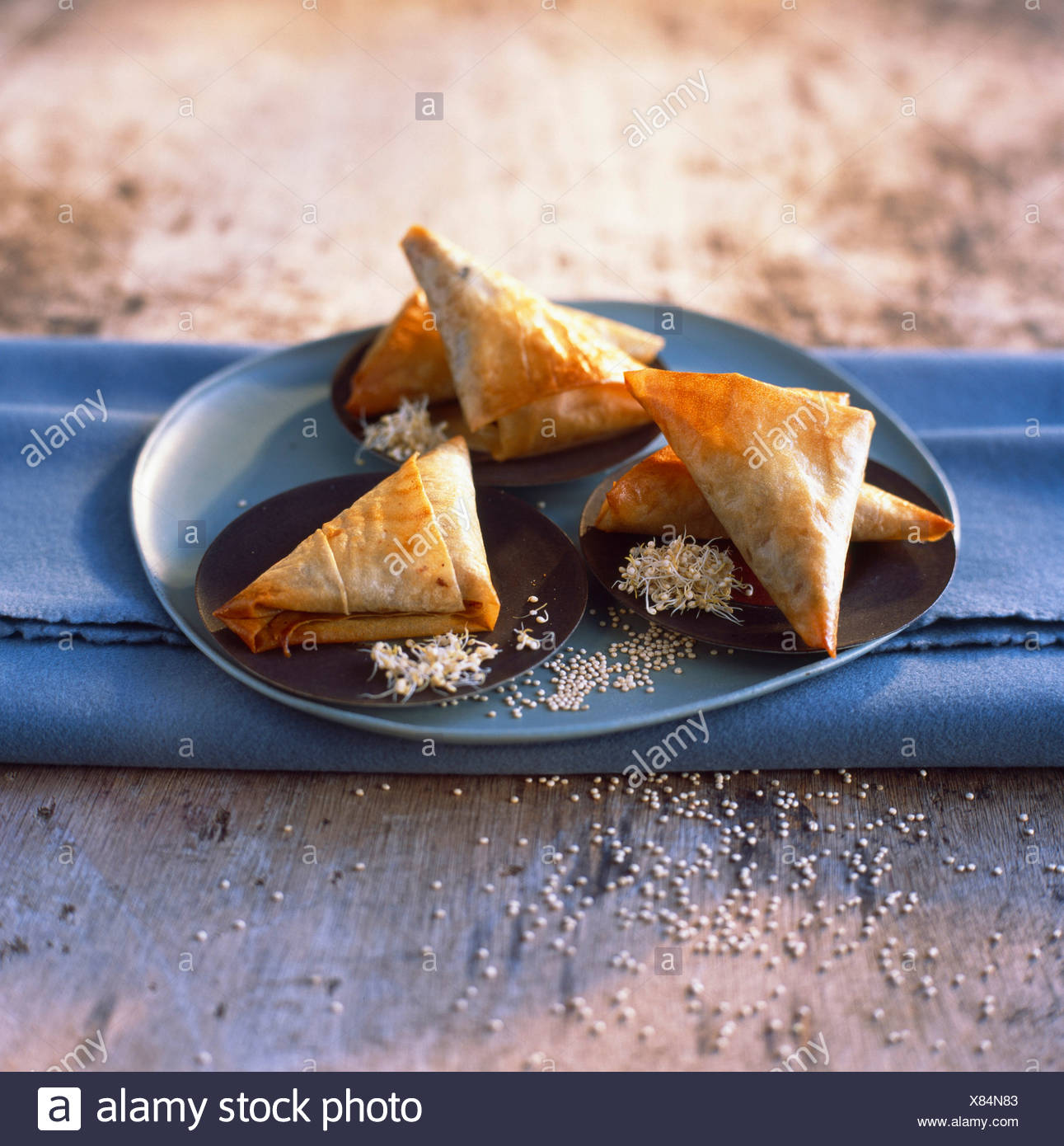 Samoussas filled with quinoa and preserved lamb - Stock Image