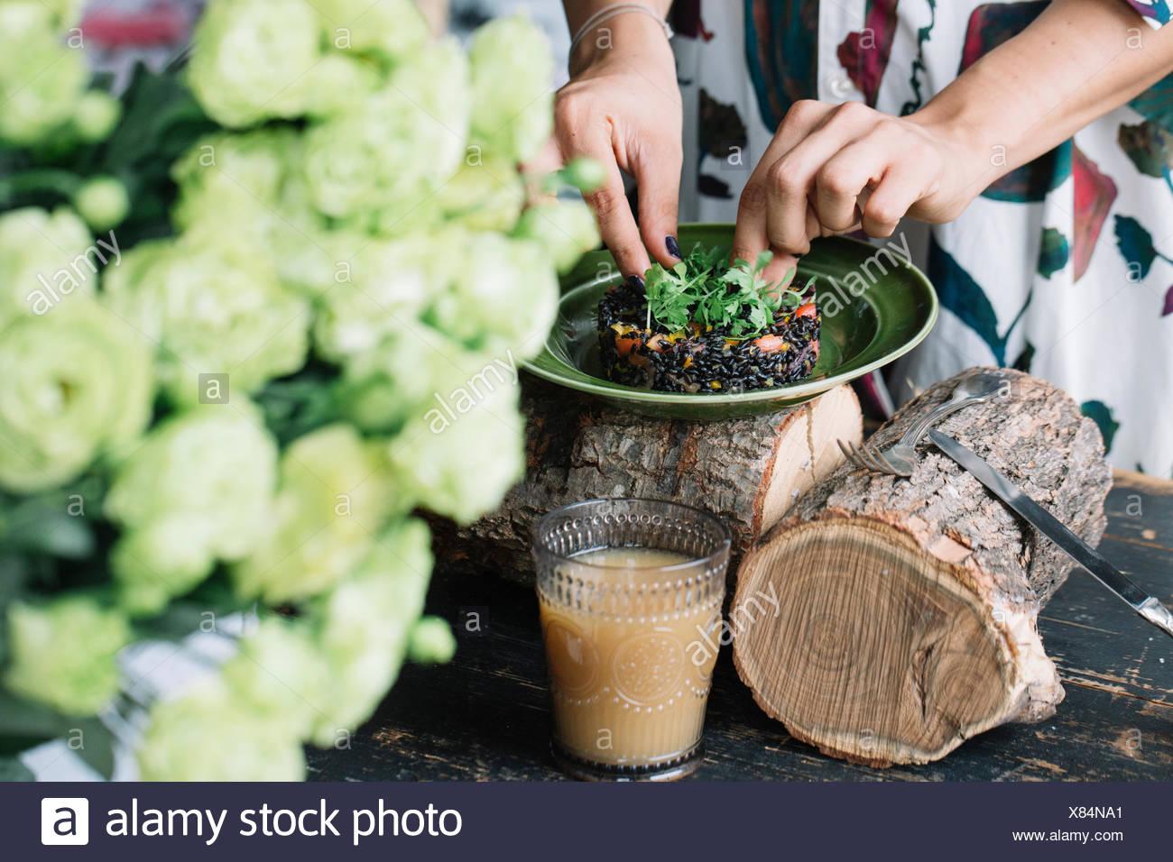 Woman preparing vegetarian dish - Stock Image