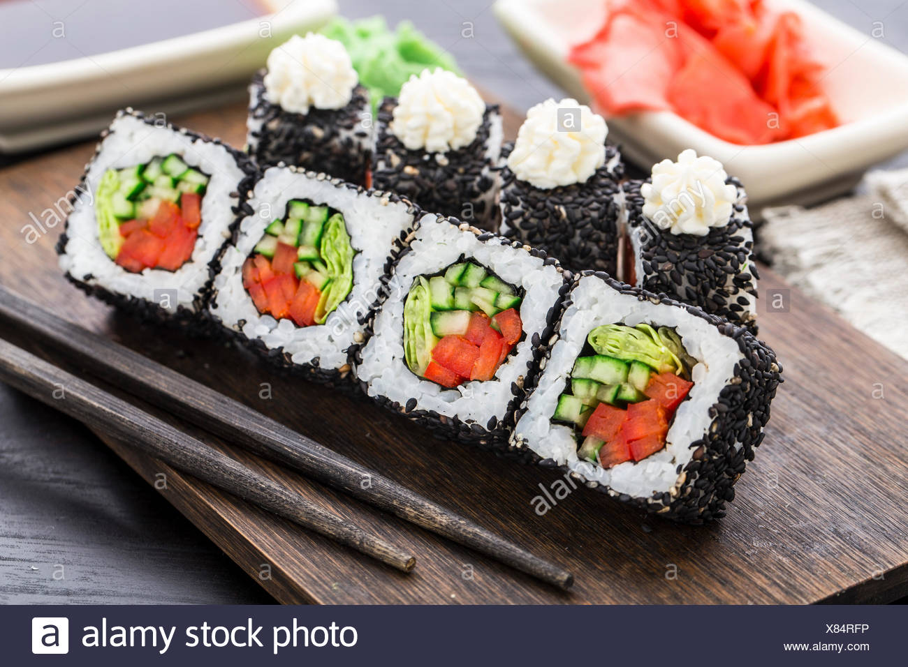 Sushi roll with salmon, shrimp and tomato - Stock Image